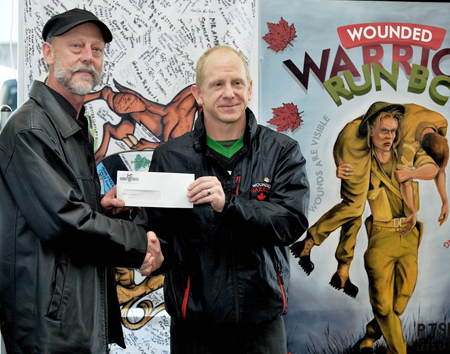 Dave Goudy presenting cheque to Dan Bodden